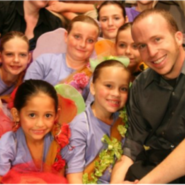Mr. Hanks with young performers