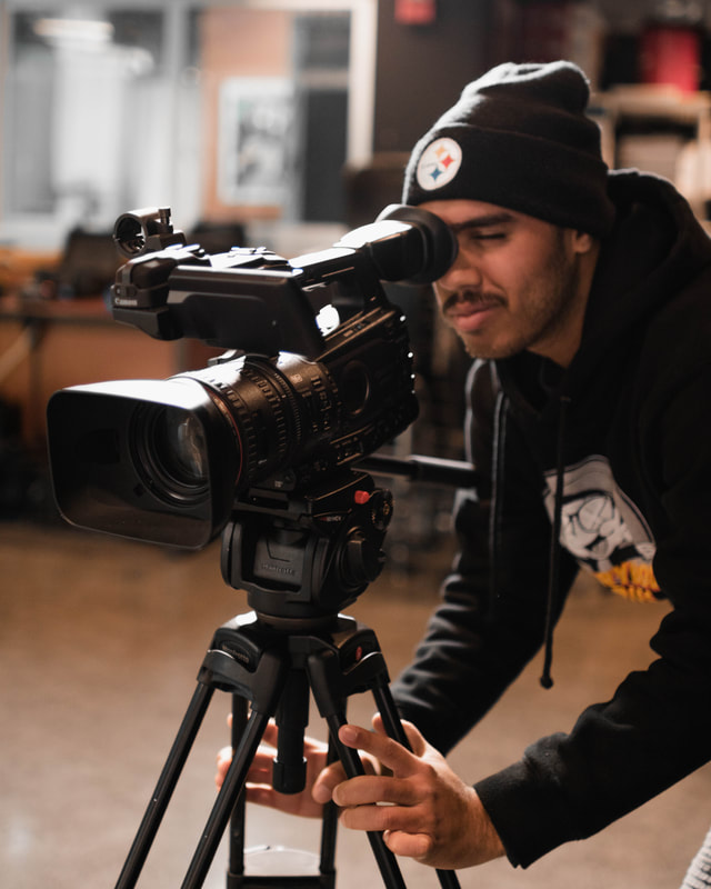 A Film 2 student records with a studio camera. Photo by Seth Gardner.