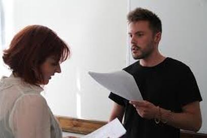 An actor works on a scene with a partner.